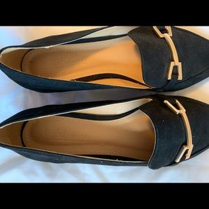 Black pointed loafers